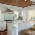 tropical-style-kitchen-with-arctic-white-quartz-counter-and-aqua-glass-backsplash